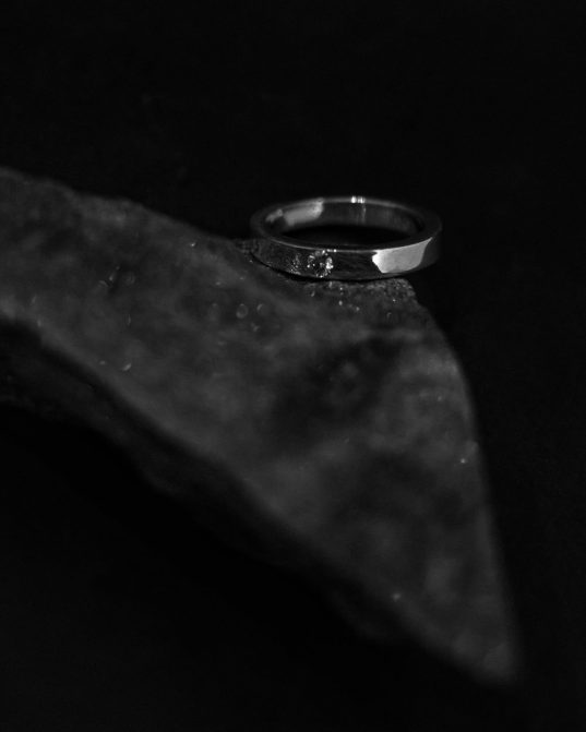 band ring made from sterling silver and subtly highlighted with white moissanite. it will fit you like a second skin thus the day will not pass by without wearing it.