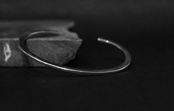 silver cuff with iconic shape and an open cuff construction. stack this piece with other bracelets for a bold look, or simply wear it on its own. it's slightly adjustable in size ranging. available for women, men and also kids.