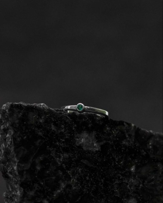 a round silver ring that feels glamorous without being over-the-top ___a super slim band works to make this emerald sparkler feel dainty on the hand.