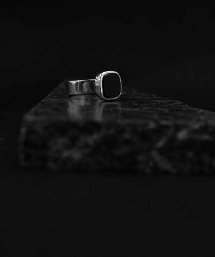 the new classic ___ notable mens signet ring, square onyx mixed with shiny sterling silver.