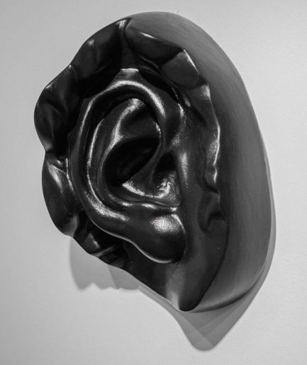 black DAVID'S EAR plaster head by Rihards Ābeltiņš