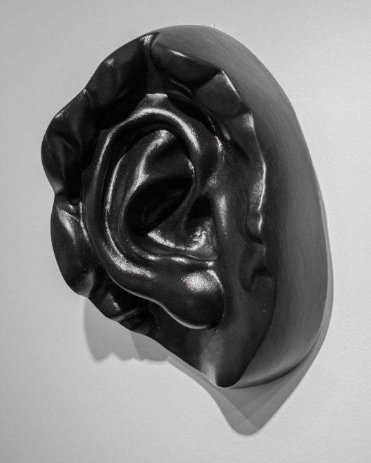 black DAVID'S EAR plaster head by Rihards Ābeltiņš