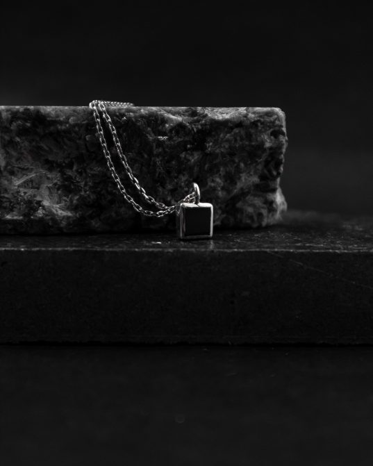 pendant with a 7mm square onyx stone set in the center of a sterling silver frame, this pendant will create a captivating and magnetic atmosphere around you at all times ___match with our 170321 ring. silver chains are not included and must be purchased separately.