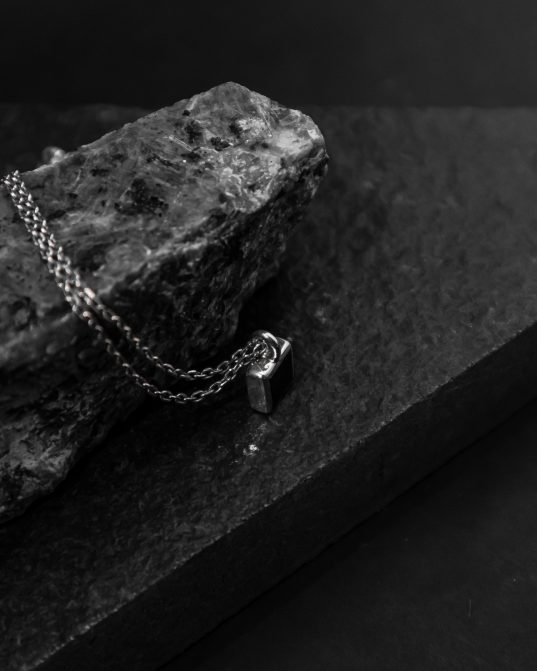 with a 7mm square onyx stone set in the center of a sterling silver frame, this pendant will create a captivating and magnetic atmosphere around you at all times ___match with our 170321 ring. silver chains are not included and must be purchased separately.
