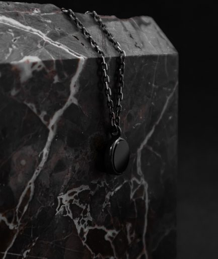 pendant with a 13 mm onyx set in the center of sterling silver frame ___match with our 180820 ring silver chains are not included and must be purchased separately.