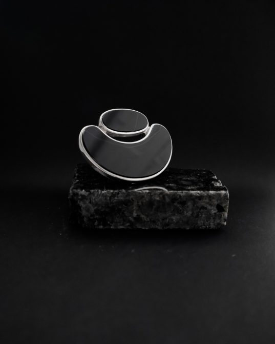 leave everyone breathless and own the space, by wearing this bold sterling silver ring with two different sized onyx pieces. the ring symbolizes the unity of two and their coherence.