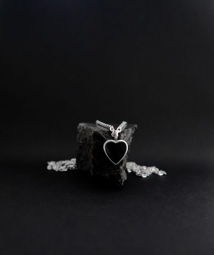 although it's minimalistic and quite simple, this pendant, with a heart shaped onyx set in the center of it, radiates love & warmth and will brighten your everyday life. ___silver chains are not included and must be purchased separately.